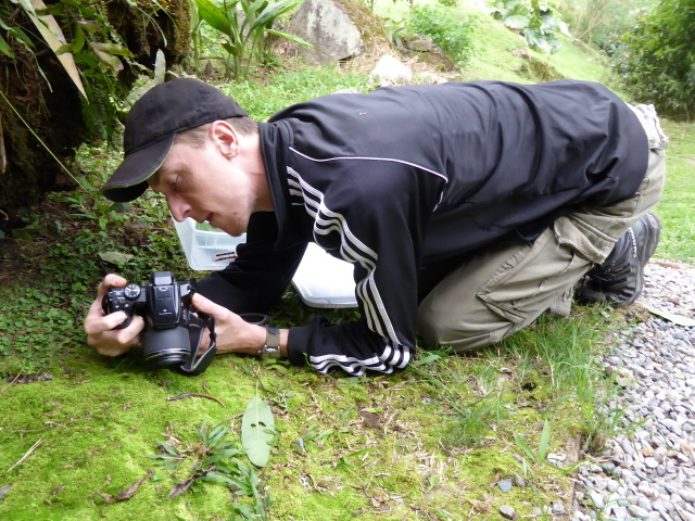 Matt taking a photo of a salamander that he found