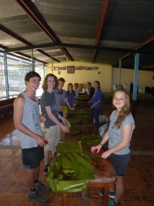 Washing banana leaves for tamales