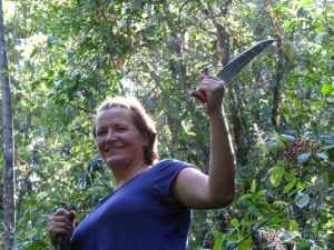 Barbara swinging a machete and looking dangerous